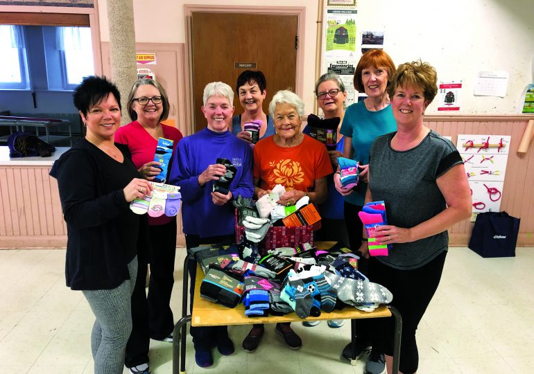 Fitness class donates socks to those in need