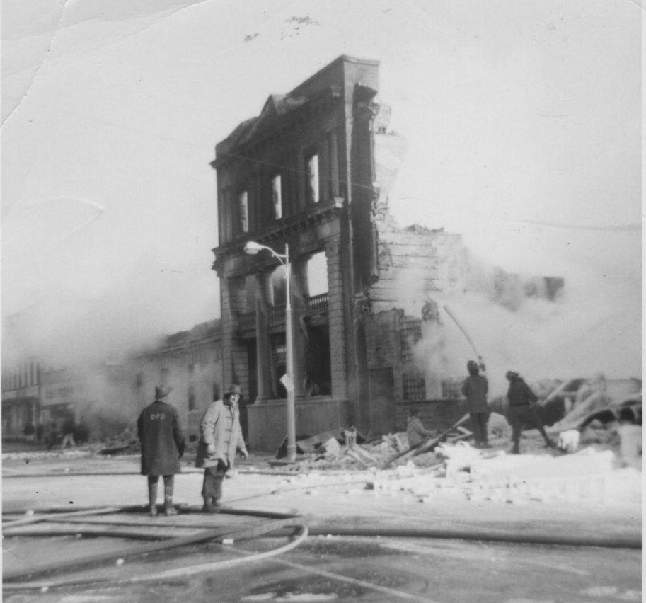 Burned hotel with single wall standing