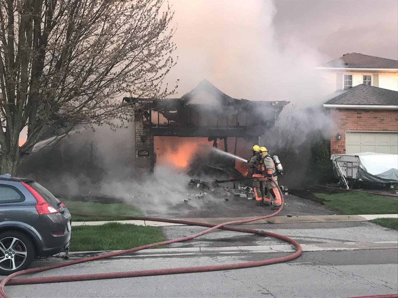 Firefighters battle residential fire