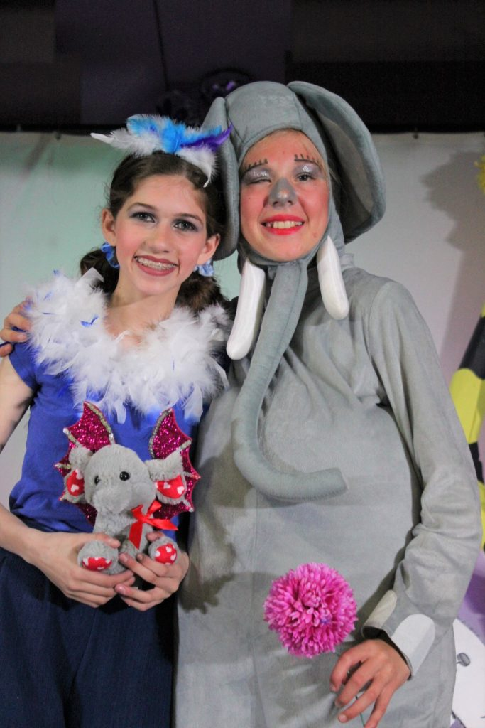 Two girls dressed up for a play
