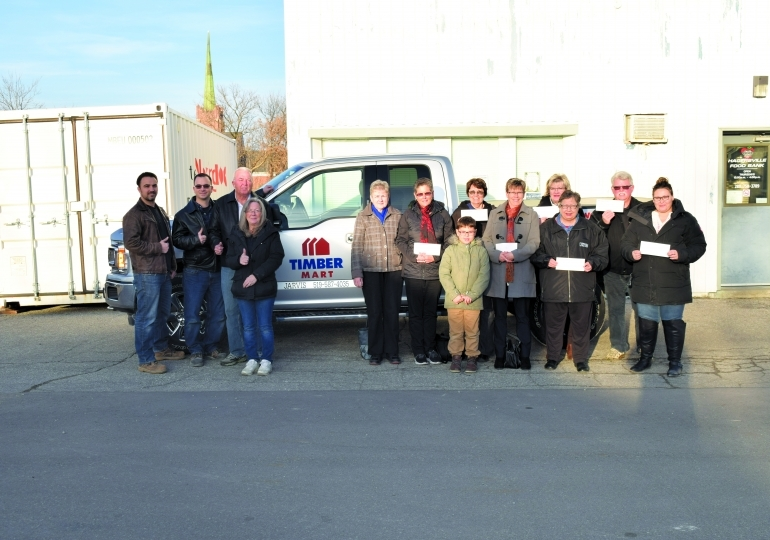 Timber Mart donates $25,000 to seven local charities