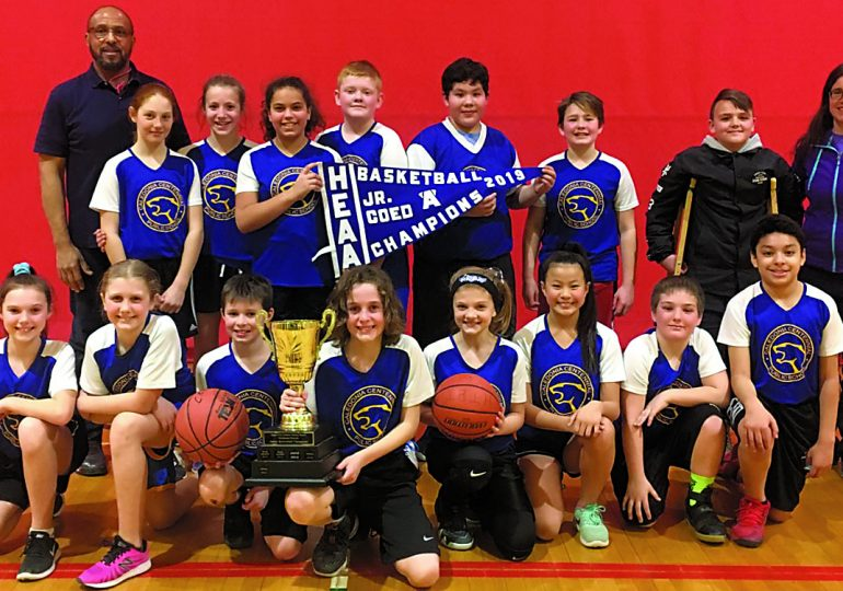 Co-ed junior basketball teams compete