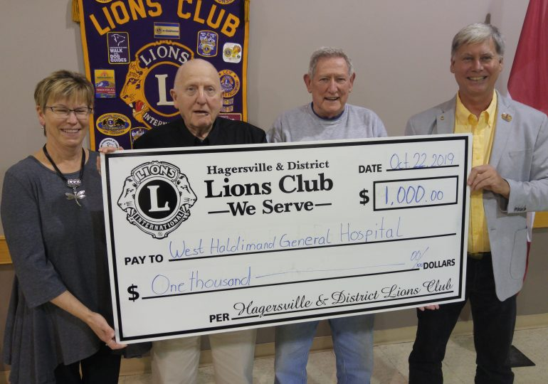 Lions donate $1,000 to WHGH