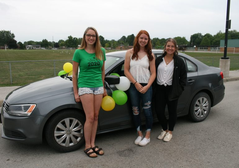 Cayuga parents celebrate CSS graduates on the road