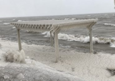 High winds and waves coat lakeshore in thick ice